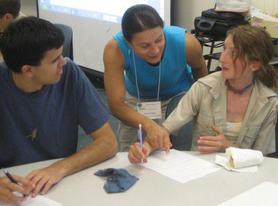 CUTeach co-director Valerie Otero works with student Learning Assistants