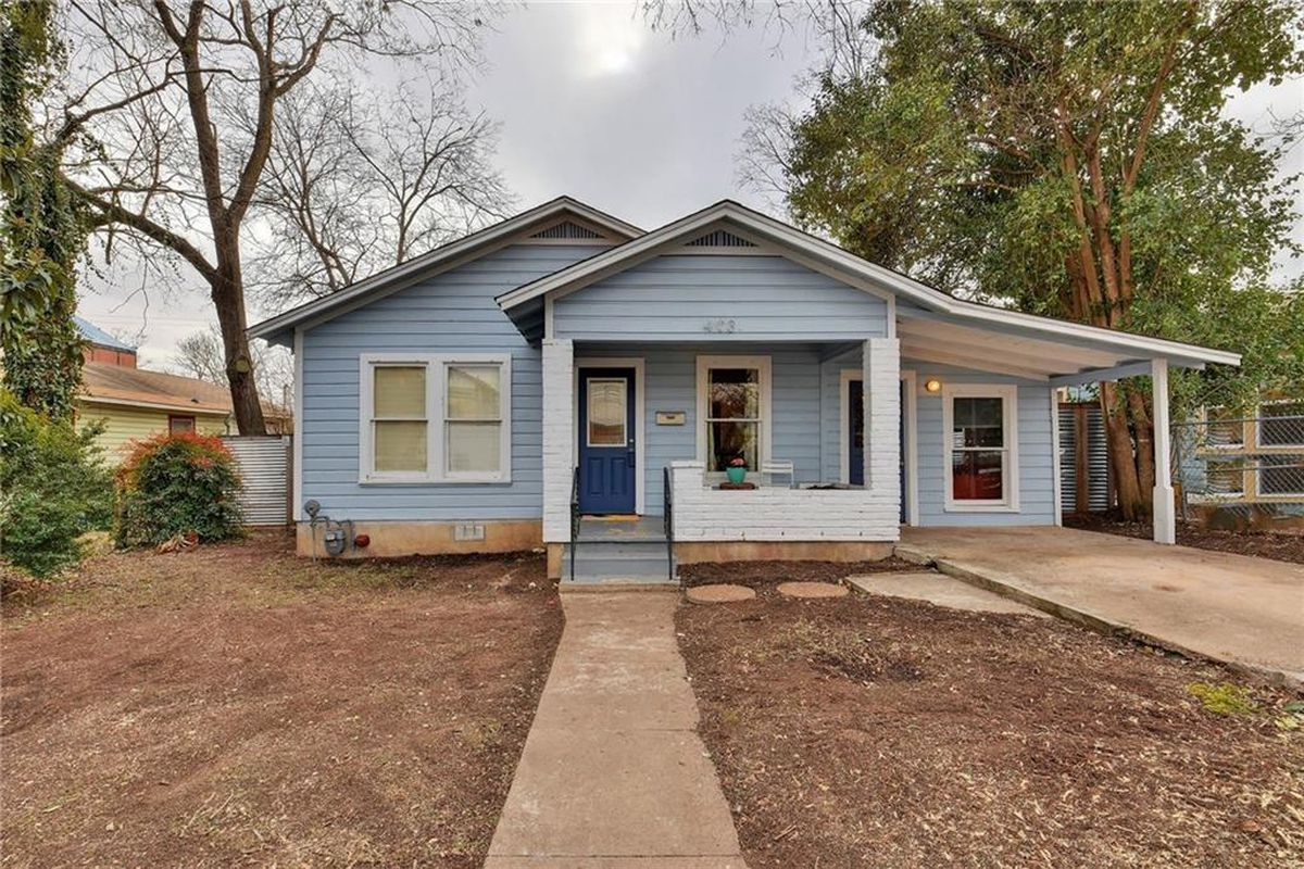 1950 wood frame home painted light blue