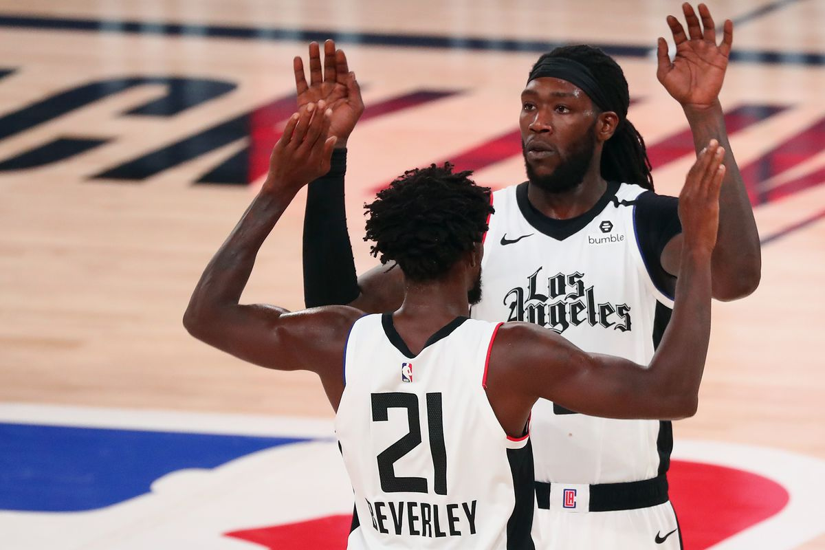 LA Clippers forward Montrezl Harrell celebrates with guard Patrick Beverley after defeating the Denver Nuggets in game three of the second round of the 2020 NBA Playoffs at AdventHealth Arena.