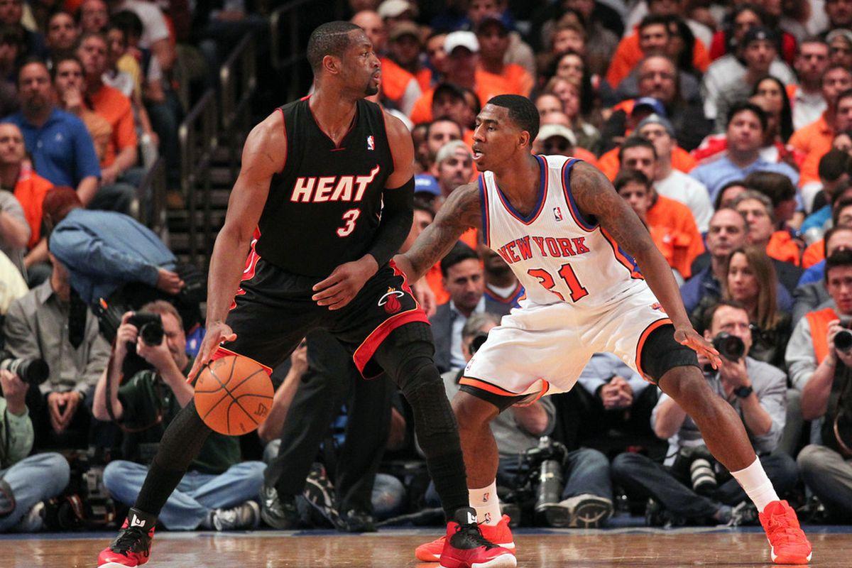 Apr 15, 2012; New York, NY, USA;  New York Knicks guard Iman Shumpert (21) defends Miami Heat shooting guard Dwyane Wade (3) during the third quarter at Madison Square Garden.  Miami won 93-85.  Mandatory Credit: Anthony Gruppuso-US PRESSWIRE