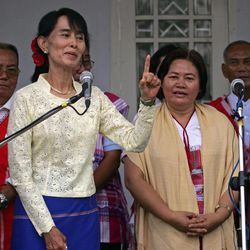 Myanmar's pro-democracy leader Aung San Suu Kyi, second left, talks to journalists during a press conference after meeting with the representatives of the Karen National Union (KNU) at her lakeside residence Sunday, April 8, 2012, in Yangon, Myanmar.