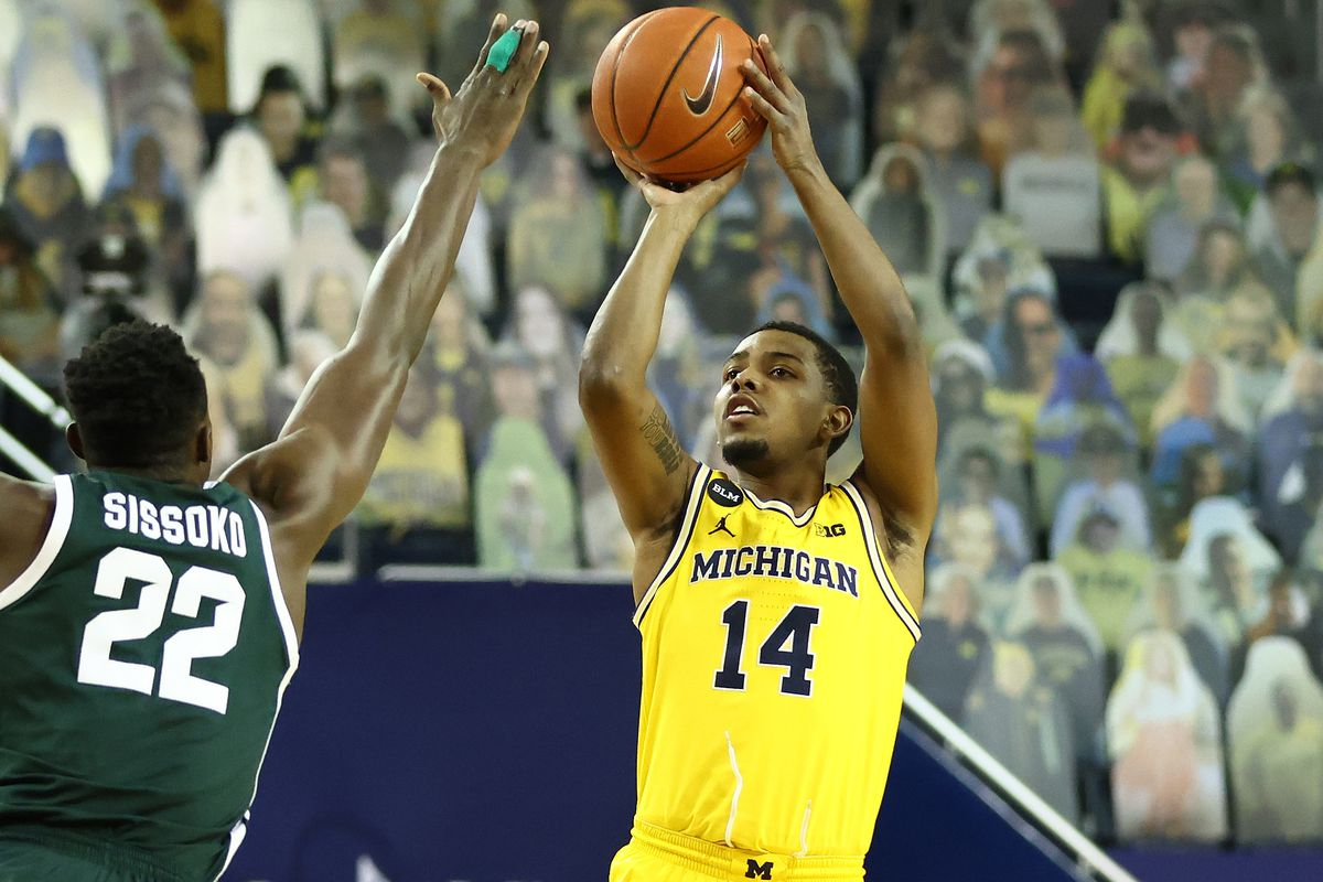 Rico Ozuna-Harrison #14 of the Michigan Wolverines plays against the Michigan State Spartans at Crisler Arena on March 04, 2021 in Ann Arbor, Michigan.