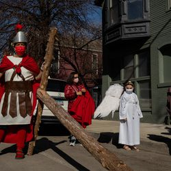 People join the Via Crucis procession in Pilsen, Friday morning, April 2, 2021. The annual Via Crucis is a Good Friday tradition that reenacts the Stations of the Cross, a Catholic devotion that recounts Jesus' passion and death.