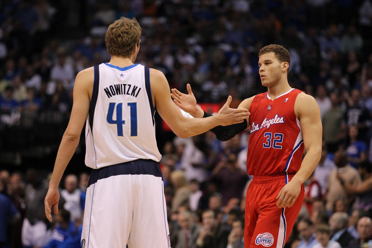 April 2, 2012; Dallas, TX, USA; Dallas Mavericks forward Dirk Nowitzki (41) meets with Los Angeles Clippers forward Blake Griffin (32) prior to the game at American Airlines Center.  Mandatory Credit: Matthew Emmons-US PRESSWIRE