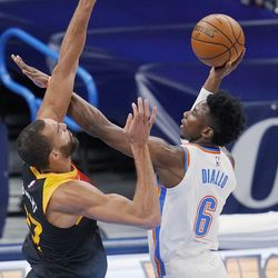 Oklahoma City Thunder guard Hamidou Diallo (6) shoots as Utah Jazz center Rudy Gobert (27) defends during the first half of an NBA basketball game in Oklahoma City, Monday, Dec. 28, 2020.