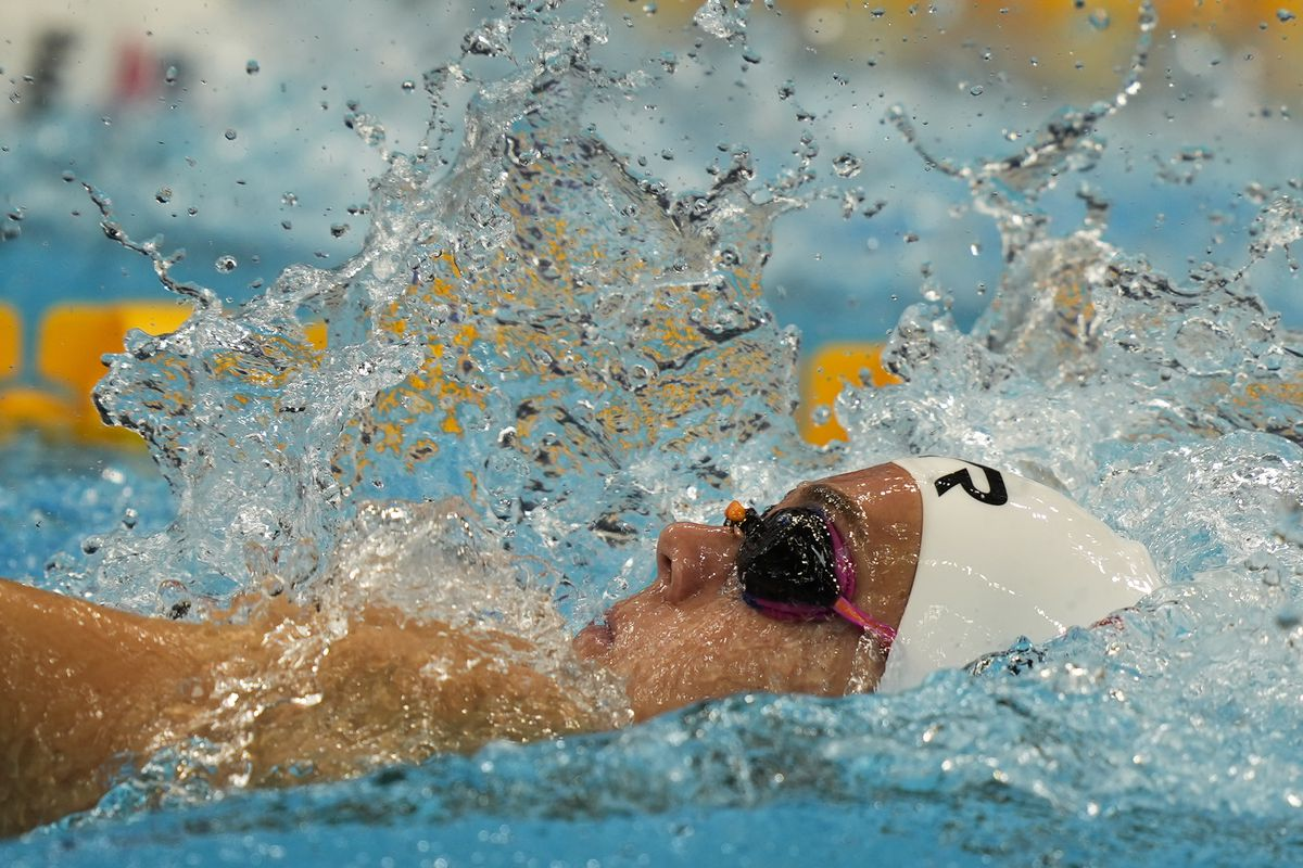 Rhyan Elizabeth White of the United States swims in a heat of the women's 200-meter backstroke at the 2020 Summer Games,