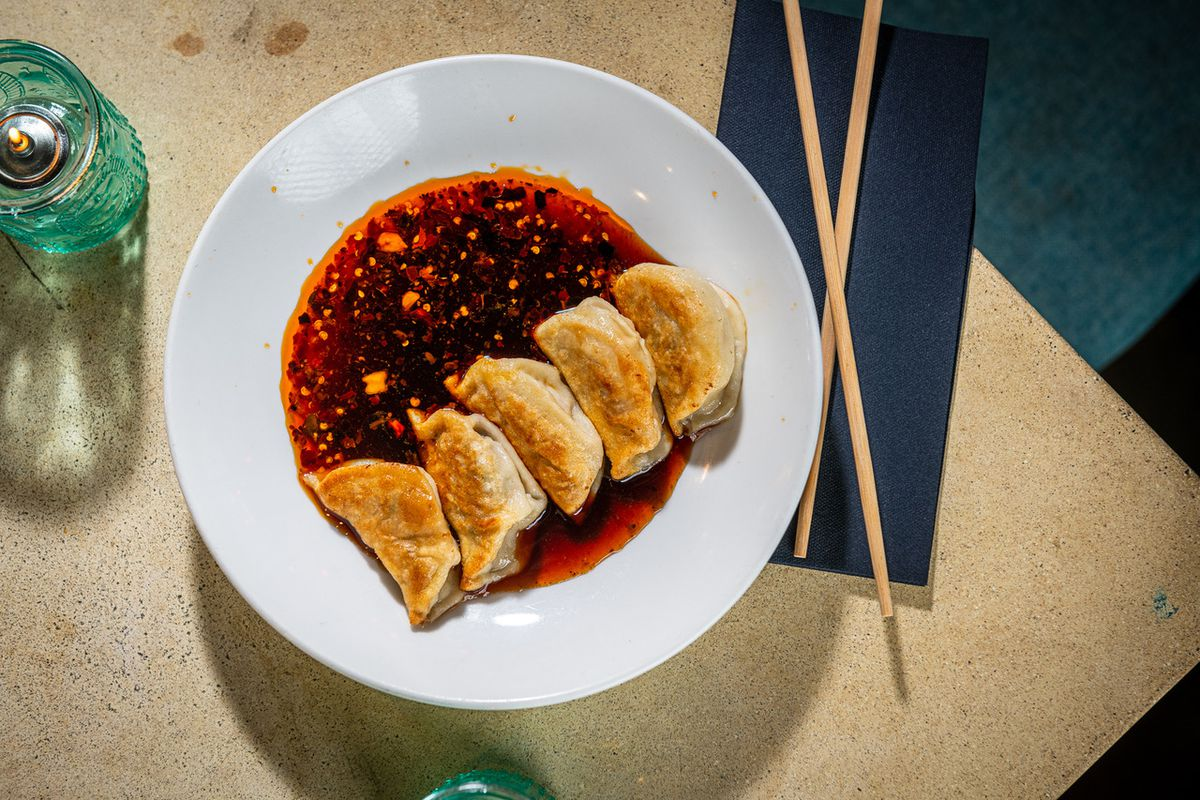 Dumplings in dipping sauce at Bar Chinois
