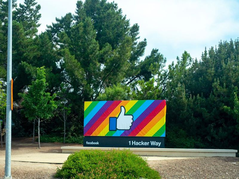 A Facebook thumbs-up billboard at One Hacker Way.