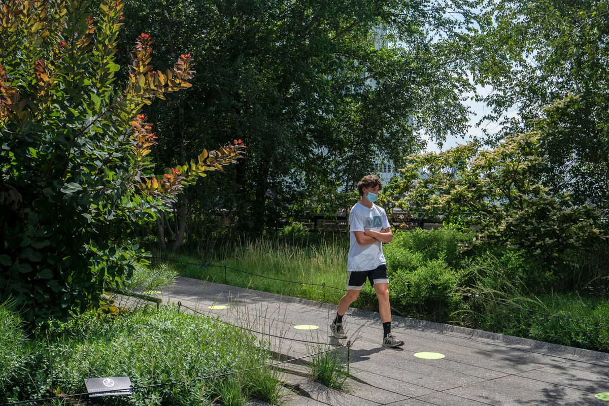 A visitor on the High Line follows the socially-distanced green dots from Gransevoort Street to 23rd Street, July 17, 2020.