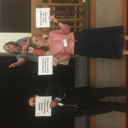 Amy Miner, a BYU education professor, leads a panel discussion as LDS Educators Association president-elect David Boren and Sarah Kunz hold signs at the association's first conference on Saturday, July 15, 2017.