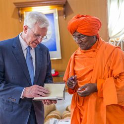 Elder D. Todd Christofferson, left, a member of the Quorum of Twelve Apostles for The Church of Jesus Christ of Latter-day Saints, interacts with Swami Agnivesh  a former member of Legislative Assembly, an Arya Samaj scholar and a social activist,   prior to attending an award ceremony at the MIT World Peace university, Pune, Maharashtra, India, on August 14, 2017.