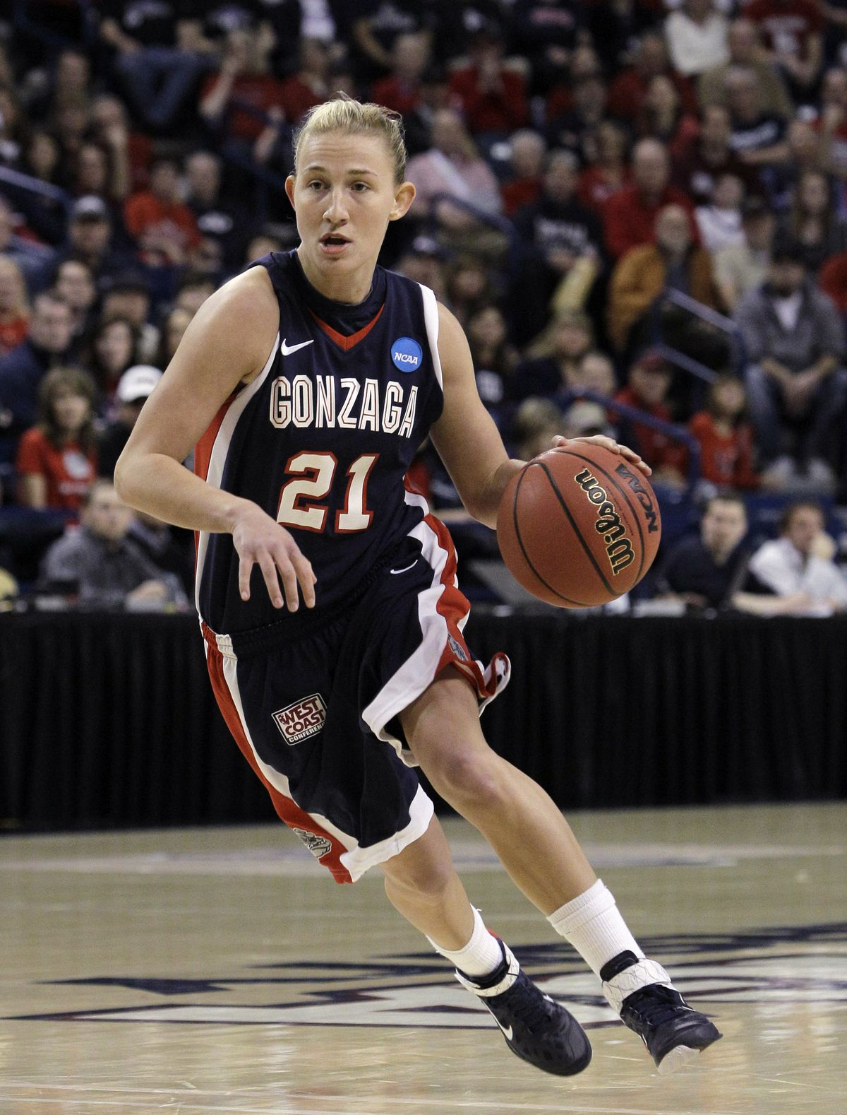 While at Gonzaga, Courtney Vandersloot became the first player in NCAA history to score more than 2,000 points and total more than 1,000 assists.