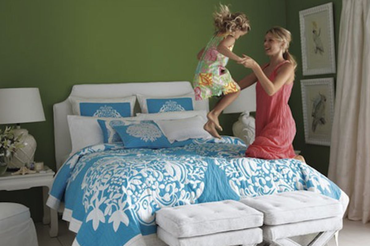 """Wearing a Lilly Pulitzer dress to bounce on your Lilly Pulitzer bedspread is one step away from needing an intervention. Image via <a href=""""http://www.stylelist.com/2010/03/28/lilly-pulitzer-home-garnet-hill/"""">StyleList</a>"""