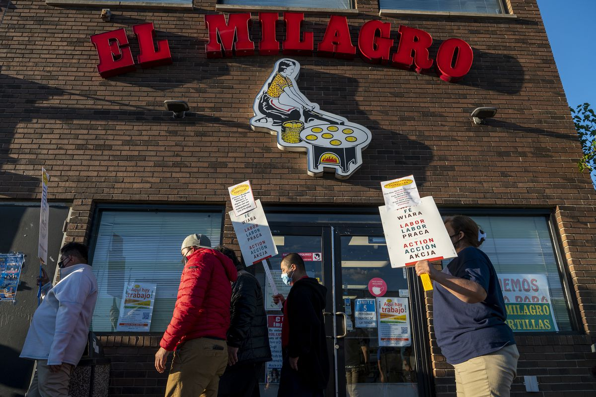 A group of El Milagro workers picket in front of the El Milagro headquarters at 3050 W. 26th St. in Little Village on Thursday, Sept. 23, 2021. Workers walked off the job at both the Little Village and Pilsen production facilities over allegations of poor working conditions.