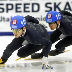 John-Henry Krueger (102) and J.R. Celski (101) compete in the men's 1000-meters during the U.S.Olympic short track speedskating trials Sunday, Dec. 17, 2017, in Kearns, Utah. (AP Photo/Rick Bowmer)