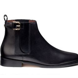 """<b>Massimo Dutti</b> elastic ankle boots with buckle, <a href=""""http://www.massimodutti.com/webapp/wcs/stores/servlet/product/duttius/en/30109527/724514/2782504/ELASTIC%2BANKLE%2BBOOTS%2BWITH%2BBUCKLE"""">$198</a>"""