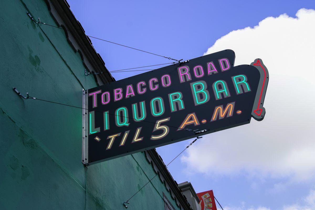 "Neon sign that reads ""Tobacco Road liquor bar 'til 5am"""