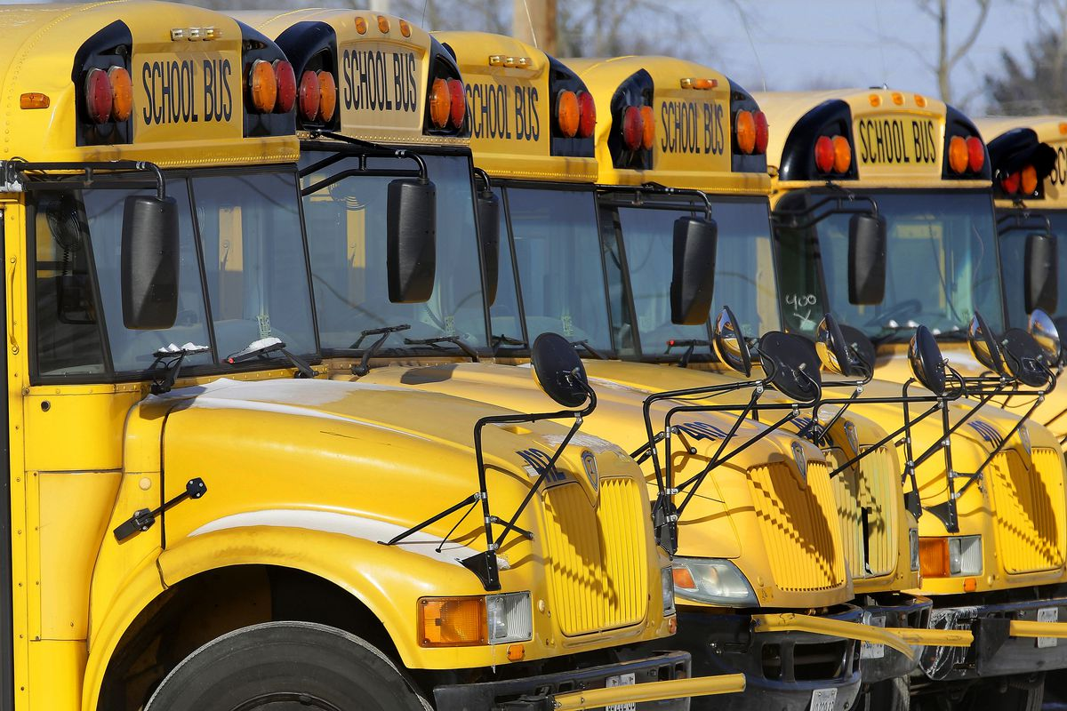 FILE - This Jan. 7, 2015 file photo shows public school buses parked in Springfield, Ill. Child abuse increases the day after school report cards are released \_ but only when kids get their grades on a Friday, a Florida study released on Monday, Dec. 17,