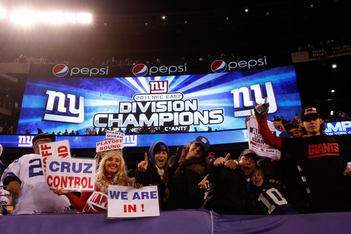 EAST RUTHERFORD, NJ - JANUARY 01:  Fans celebrate after the New York Giants defeated the Dallas Cowboys at MetLife Stadium on January 1, 2012 in East Rutherford, New Jersey.  (Photo by Rich Schultz/Getty Images)
