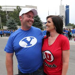 Married opposing fans Chris and Michelle Tremea wait to enter the stadium prior to the Utah-BYU game in Provo on Saturday, Sept. 9, 2017.