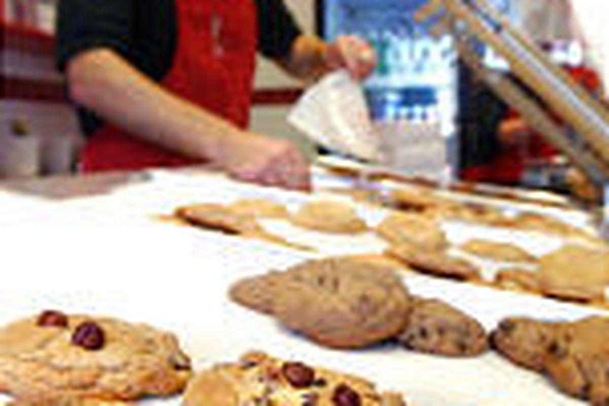 Joel Clark sells cookies at The Gateway, the second Utah outlet.