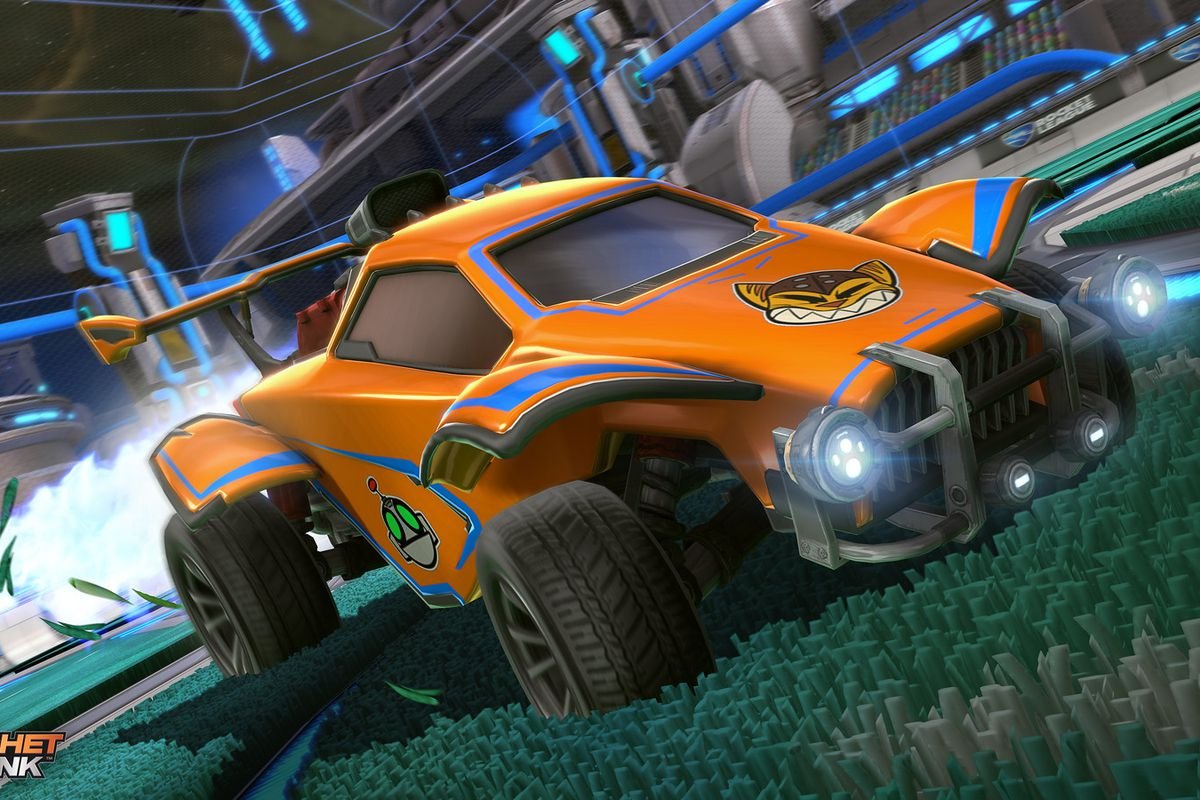 Rocket League - a car, decorated with Ratchet & Clank decals, soars through the air majestically