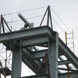 2:03 p.m. Worker at the top of the right field video board structure -