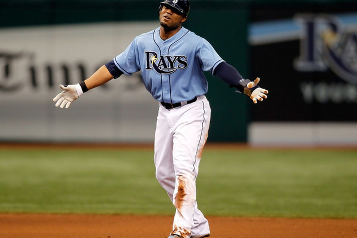 ST. PETERSBURG - APRIL 25:  Outfielder Carl Crawford #13 of the Tampa Bay Rays pleads with the umpire against the Toronto Blue Jays during the game at Tropicana Field on April 25, 2010 in St. Petersburg, Florida.  (Photo by J. Meric/Getty Images)