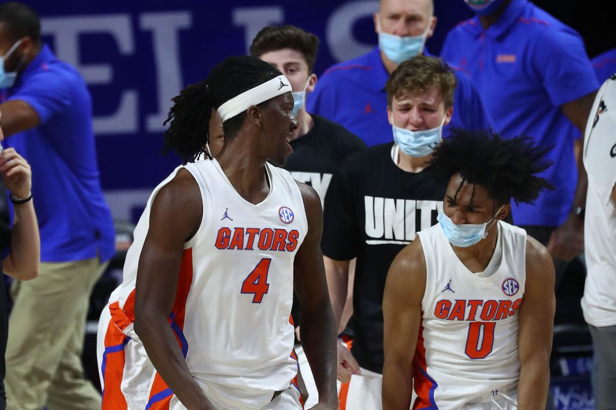 lorida Gators forward Anthony Duruji is congratulated by guard Ques Glover and teammates during the second half against the Tennessee Volunteers at Billy Donovan Court at Exactech Arena.