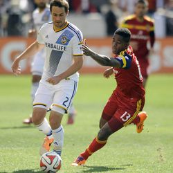 Real Salt Lake forward Olmes Garcia (13) gives chase to Los Angeles Galaxy defender Todd Dunivant (2) during a game at Rio Tinto Stadium on Saturday, March 22, 2014.