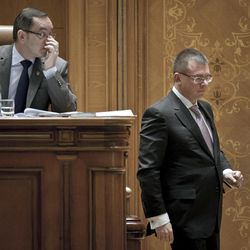 Romanian Prime Minister Mihai Razvan Ungureanu, right,  walks during a special parliament session in Bucharest, Romania, Friday, April 27, 2012. Governments in Romania and the Czech Republic on Friday face no confidence votes with opposition parties tapping into widespread public anger over biting austerity measures, cronyism and corruption.
