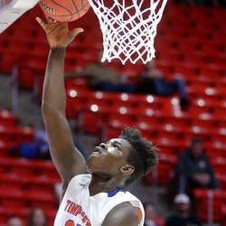Timpview's Yaw Reneer shoots during the 5A boys basketball state quarterfinals against Murray at the Huntsman Center in Salt Lake City on Tuesday, Feb. 25, 2020. Timpview won 53-32.