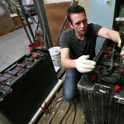 Bob Ziroll, president of EarthSafe Batteries, tests and reconditions a forklift battery at Standard Restaurant Supply in Salt Lake City on Thursday, April 25, 2013.