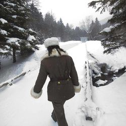 In this Monday, April 2, 2012 photo, a female North Korean soldier, working as a guide, enters what was a secret military camp during the fight against the Japanese and the site of what North Koreans say is the home of the late North Korean leader Kim Il Sung and the birthplace of his son and late leader Kim Jong Il at the foot of Mount Paektu, North Korea.