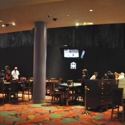 Gaming tables still ring the Center Bar space.