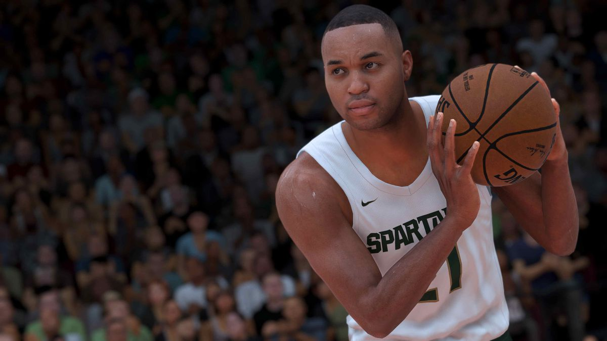 A fictitious player for the Michigan State Spartans cradles a basketball in NBA 2K21