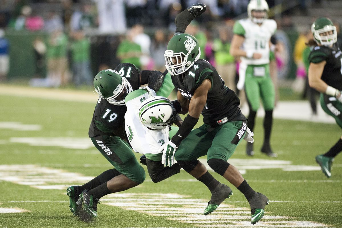 Charlotte's defense upends a Marshall receiver.