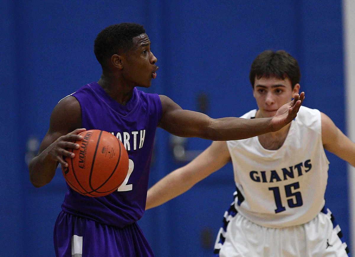Malachi Nix of Niles North tries to direct traffic during game against Highland Park.