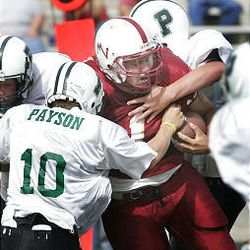 Mountain View runner Nate Stroshine is swarmed by Payson tacklers.