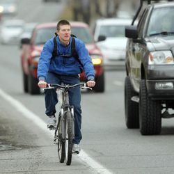 BYU student Travis Meservy rides his bike near the campus in Provo  Friday, Feb. 8, 2013.  Provo's master bike plan is nearing approval.