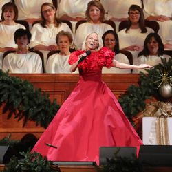Kristin Chenoweth sings with the Tabernacle Choir at Temple Square during their opening Christmas concert in Salt Lake City on Thursday, Dec. 13, 2018.