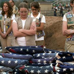 Girl Scouts participate in a prayer at an American flag retirement ceremony at the Davis County Fair in Farmington on Thursday, Aug. 15, 2013. Participants in the ceremony included the American Legion, Utah National Guard, Boy Scouts and Girl Scouts, and members of Davis County fire departments.