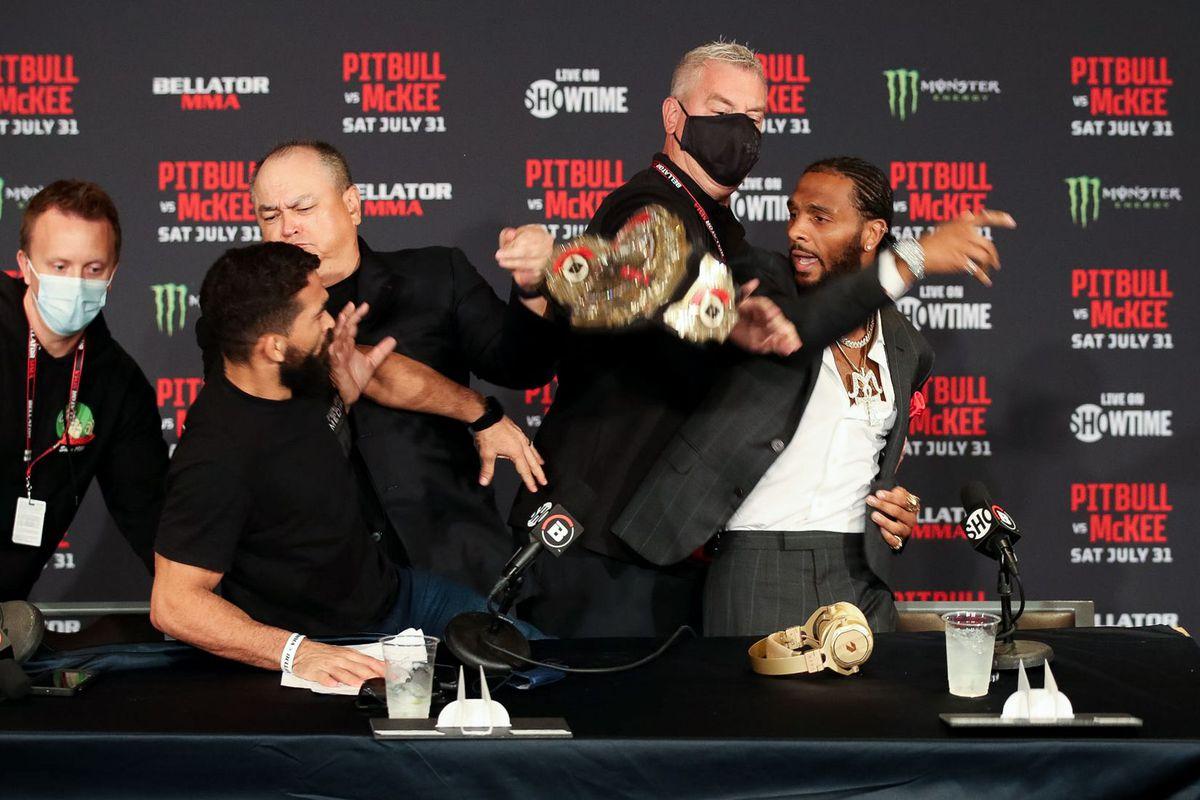 AJ McKee snatches Patricio Freire's belt at Belaltor 263 press conference.