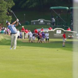 Kevin Streelmen hits his approach shot on the 18th hole in the 2019 Travelers Championship Third Round at the TPC River Highlands in Cromwell, CT on June 22, 2019.