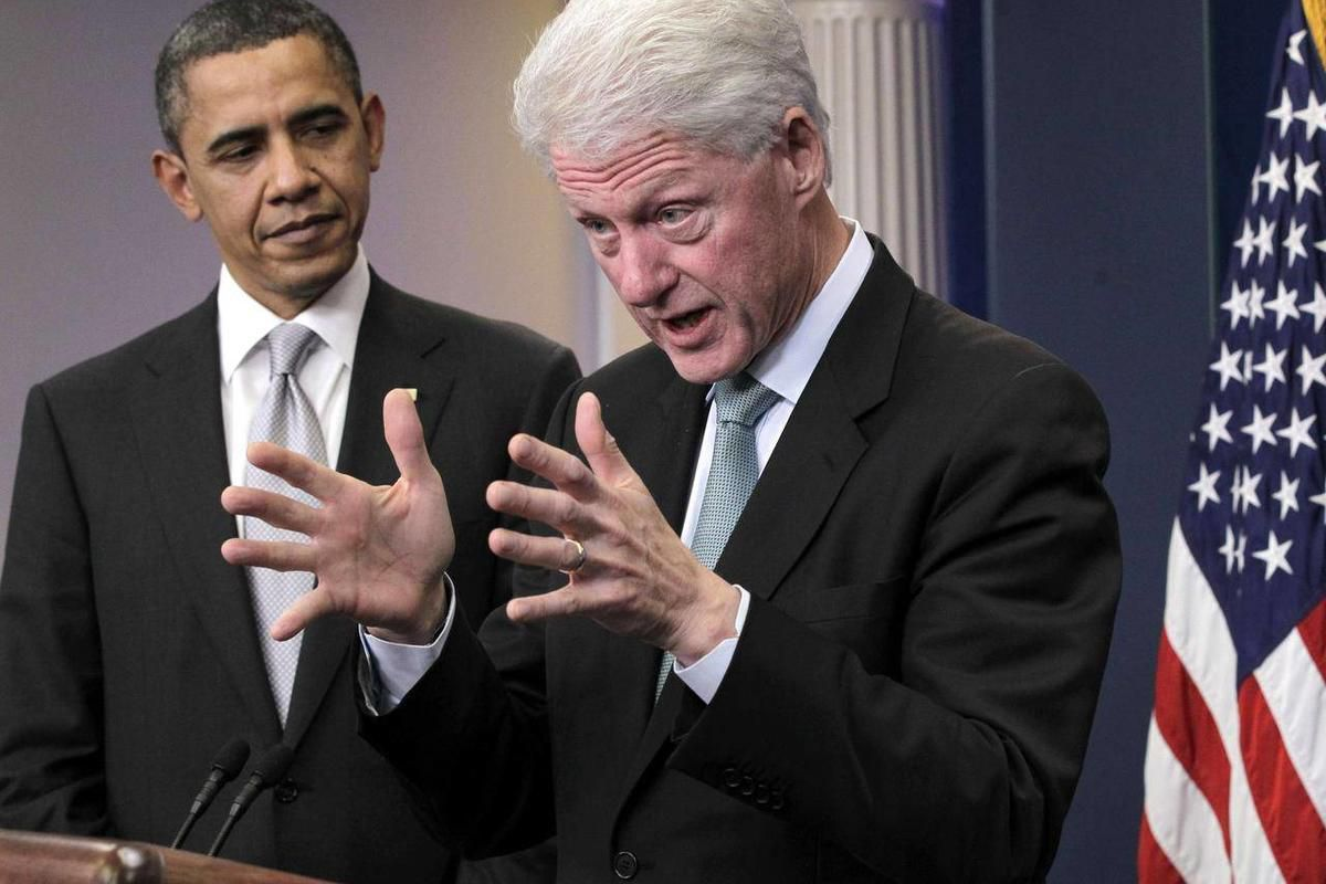 FILE -In this Dec. 10, 2010 file photo, President Barack Obama listens as former President Bill Clinton speaks in the briefing room of the White House in Washington. When Bill Clinton takes the convention stage to endorse Barack Obama later this week, it