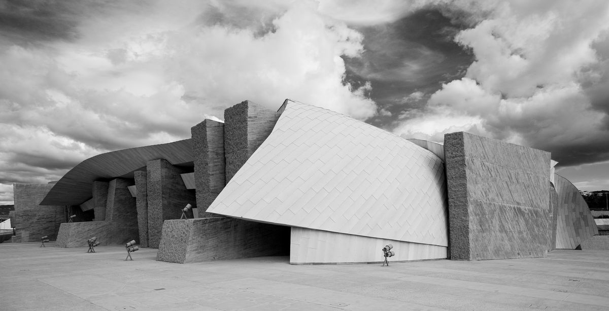 The exterior of the Magma Conference Center in Tenerife. The facade consists of large geometrically shaped blocks.