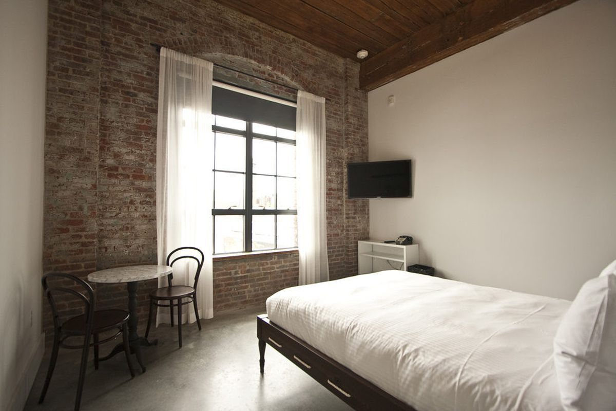 """This is a """"Brooklyn Queen"""" room, named for facing Brooklyn and having a queen size bed. Cement floors are heated."""
