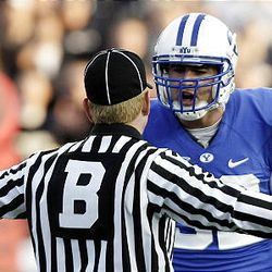 BYU tight end Dennis Pitta argues with a referee during the Cougars' game against Utah at LaVell Edwards Stadium in Provo Saturday. BYU won 26-23 in overtime.