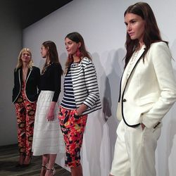 """A white suit in the foreground. Photo via <a href=""""http://instagram.com/p/eFRg1HGEjq/#"""">imninagarcia</a>/Instagram."""