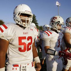 East High linebacker Patrick Palau (52) prepares to take the field for a recent game against Woods Cross.
